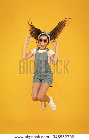 Enjoy The Ease. Summer Vacation Concept. Girl Long Curly Hair Sunglasses Tied Headscarf. Kids Clothe