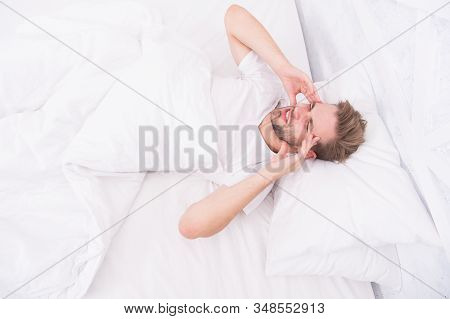 Migraine Headaches. Handsome Man Relaxing In Bed. Snoring Can Increase Risk Headaches. Common Sympto