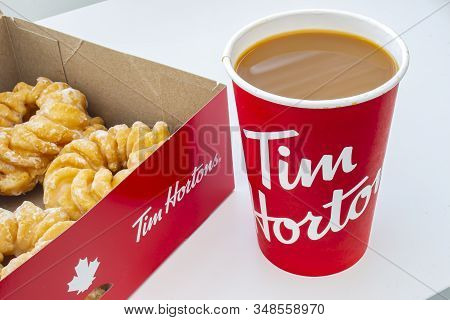 Calgary, Alberta, Canada. Feb 02, 2020. A Box Of Donuts With Honey Cruller Donuts And A Tim Hortons