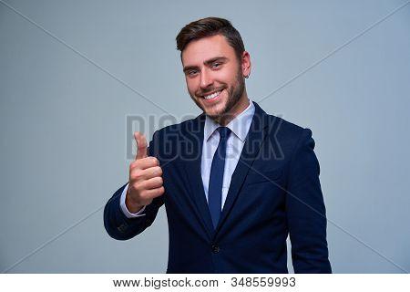 Portrait Young Smiling Businessman. Caucasian Guy Business Suit Tie Studio Gray Background. Modern B