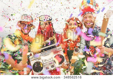 Happy Friends Celebrating Carnival Party Event Outdoor - Young Crazy People Having Fun Wearing Costu
