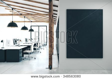 Modern Coworking Office With Empty Black Poster On Wall. Occupation And Worker Concept. Mock Up, 3d