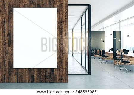 Modern Office Interior With Empty Banner On Wall. Workplace And Lifestyle Concept. Mock Up, 3d Rende