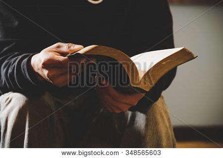 Sunday Readings Bible, A Christian Man Reading The Bible.