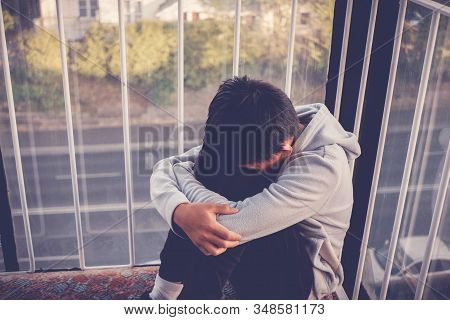 Depressed Young Preteen Teenage Boy Hugging His Knee , Children Mental Health, Domestic Violence, St