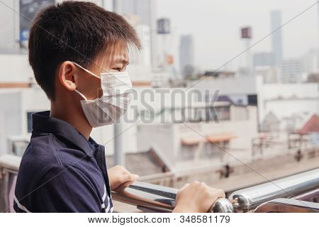 Young Asian Preteen Boy Wearing Medical Face Mask,  Wuhan Coronavirus Outbreak, Pm 2.5 Air Pollution