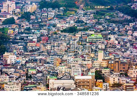 Nagasaki, Japan downtown cityscape and residential districts at twilight.