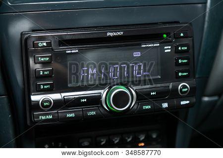 Novosibirsk, Russia - December 06, 2019:  Nissan Almera, Prology Car Dashboard Audio In Fm-receiver,