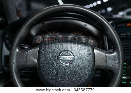 Novosibirsk, Russia - December 06, 2019:  Nissan Almera - Dashboard, Player, Steering Wheel With Log