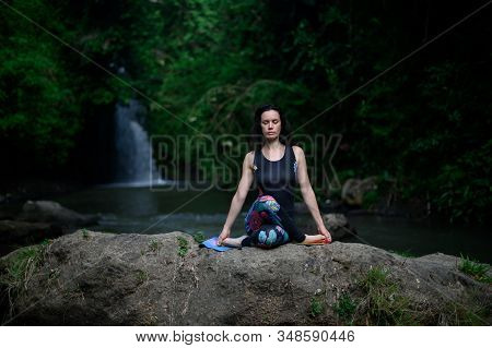 Yoga Practice And Meditation In Nature. Woman Practicing Near River.