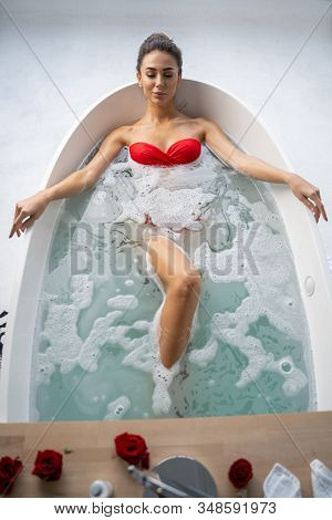 Fit Young Woman Relaxing In A Bath
