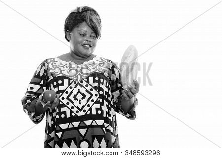Studio Shot Of Happy Fat Black African Woman Smiling While Looking At Bread And Holding Apple