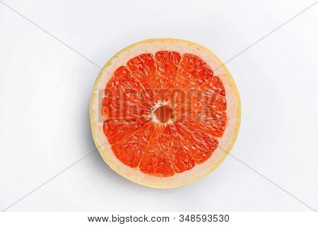 Sliced grapefruit On A White Background From Above. Red Flesh Of Grapefruit Close-up.