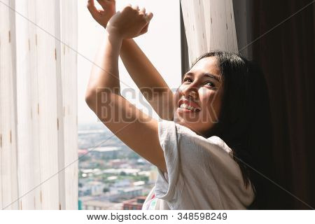 Young Diverse Woman Yawning And Stretching Out Of Apartment Block Window - Sleepy Head Tired Millenn