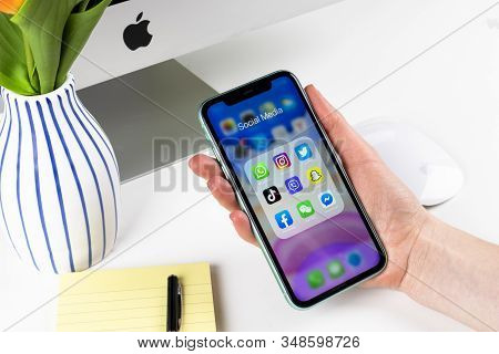 Helsinki, Finland, January 28, 2020: Apple Iphone 11 In Woman Hands With Icons Of Social Media Faceb