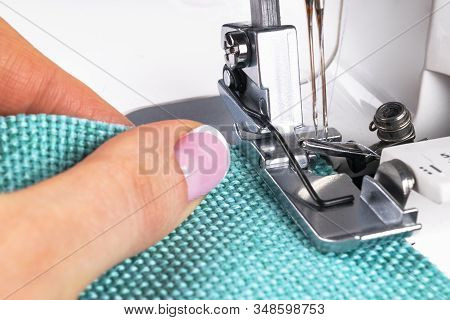 Presser Foot Of Sewing Machine With Needle And Thread Close Up. Detail Of Sewing Machine With Female