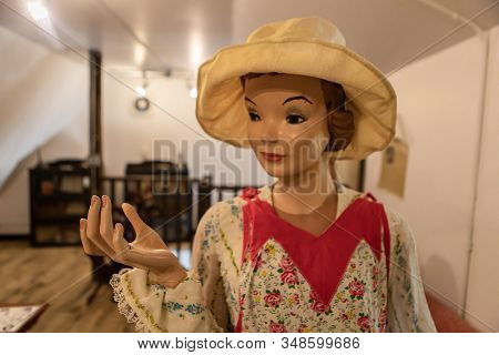 Female Mannequin In Casual Clothing And Hat From The 1980s. A Wax Figure Of A Housewife. Wax Figure