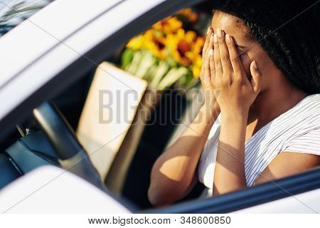 Young Woman Covering Face With Hands As She Is Scared After Crashing In Another Car