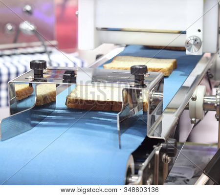 White Bread In Blue Conveyor Equipment Line For Processing ; Food And Drink Industrial Background