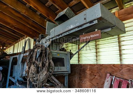 Antique Threshing Machine. Farm Equipment Was Used In The Early 20th Century For Threshing Grain, Re