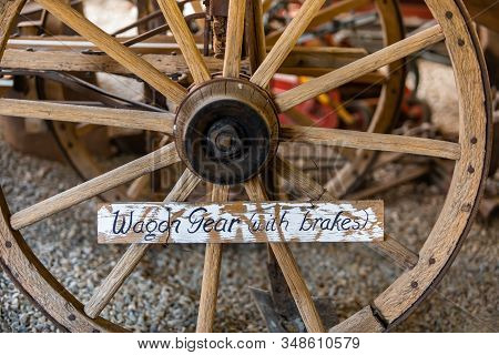 Close-up View Of Vintage Wagon Gears. An Old Wooden Cart Wagon Wheels With Brakes In The Museum, Koo