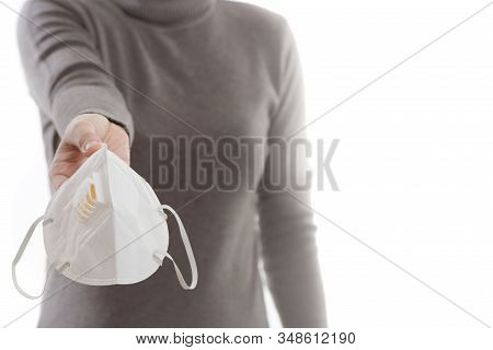 Woman Hand Holding A Dust Mask, 2.5 Isolate On A White Background. Promoting People Use Face Mask To