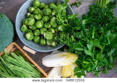 Sprouts And Endives On A Wooden Background, Belgian Vegetables