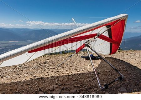 A Lightweight Delta Plane. Paragliders On The Hilltop. Extremal Hobby For Brave People. Active Holid