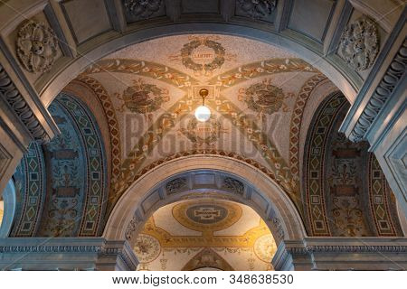 WASHINGTON - APRIL 12, 2015: Hallway and ceiling in the Library of Congress. The library officially serves the U.S. Congress.