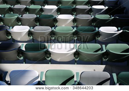 bleacher seats. Seats at a sports arena. many seats waiting for people to sit in them.