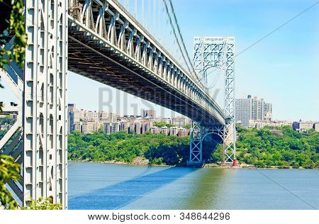 The little red lighthouse and the George Washington Bridge in New York
