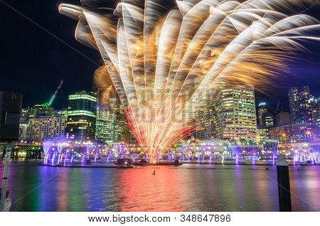 Beautiful Vivid Fireworks Display With Cityscape Skyscrapers On The Background. Sydney Darling Harbo