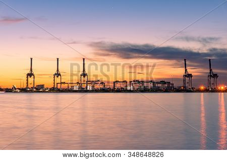 Sunset Landscape With Silhouettes Of Lifting Cranes And Frames At Port Melbourne, Australia