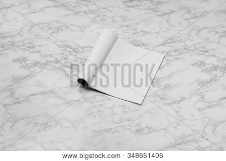Mock-up Magazine, Newspaper Or Catalog Isolated On White Marble Background. Blank Page For Mockups O