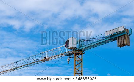 Construction Site With Crane And Building. Real Estate Industry. Crane Use Reel Lift Up Equipment In