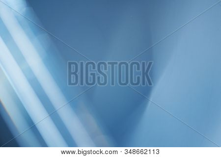 Abstract Lens Flare backdrop, Technology, prism Bokeh Lights. Photo of Leaking Reflection of a Glass, Crystal, Defocused Shining Colorful Light Leaks, Rays blue Background