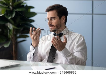 Businessman Holding Smartphone Speaking Through Microphone Sending Voice Message