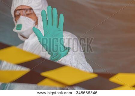 Epidemiologist Gesturing Stop Hand Sign In Coronavirus Quarantine, Selective Focus