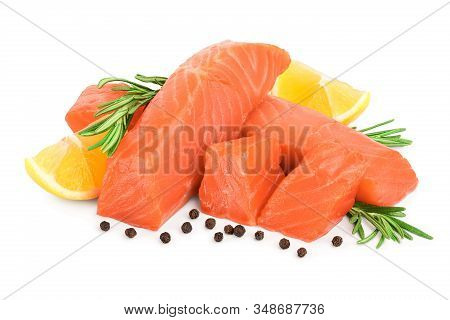 Raw Salmon Piece Cube With Rosemary, Lemon And Peppercorn Isolated On White Background Close Up