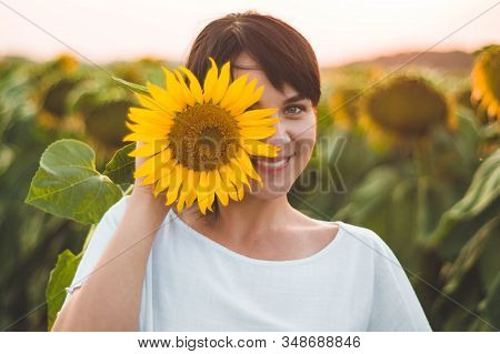 Beautiful Young Woman In A Sunflower Field. Portrait Of A Young Woman In The Sun. Pollen Allergies C