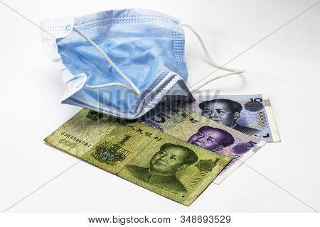 The Concept Coronovirus And Economy Of China Chinese Yuan Money Lie Near Medical Hygiene Mask