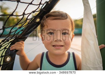 Cute Young Mixed Race Boy Smiling In The Sun