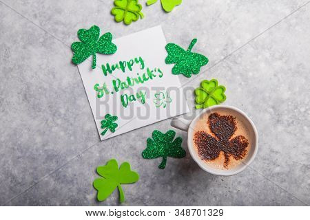 Happy Saint Patricks Day Flat Lay Composition With Card, Coffee Drinks, Shamrock Leaf Clovers