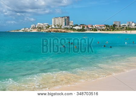 Mullet Bay, Saint Martin - December 17, 2018: Tourists And Locals Bathe On The Mullet Bay Beach Whic