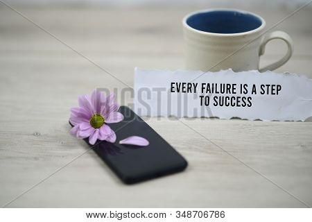 Inspirational Quote - Every Failure Is A Step To Success. With Morning Cup Of Coffee And Purple Dais