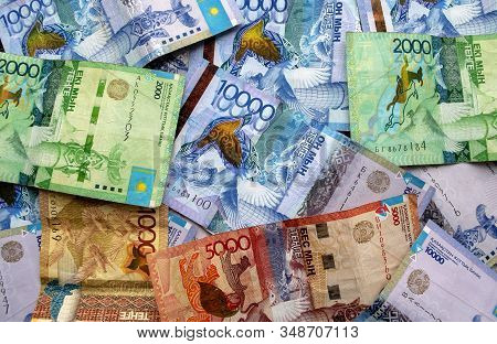 Kazakhstan National Currency, Top View Of Mixed Tenge Banknotes. One Thousand, Two Thousand, Five Th