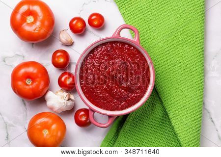 Tomato Soup With Parsley, Onion And Garlic On Marble Background. Comfortable Food. Rustic Style. Cop