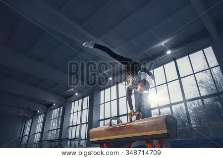 Little Male Gymnast Training In Gym, Flexible And Active. Caucasian Fit Little Boy, Athlete In Sport