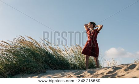 Summer Freedom And Relaxing Leisure. Young Relaxed Woman Enjoying The Feel Of The The Breeze At The
