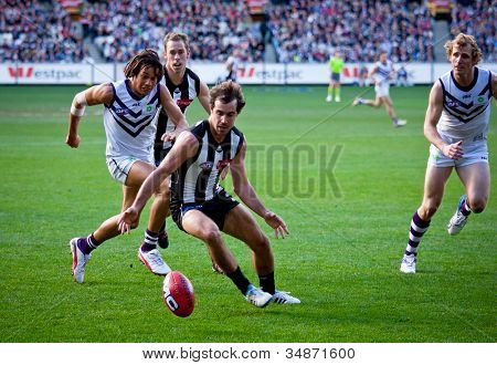 MELBOURNE - JUNE 30 : Steele Sidebottom attacks the ball during Collingwood's win over Fremantle on June 30, 2012 in Melbourne, Australia.